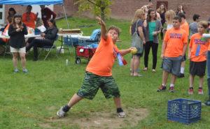 Student throwing softball