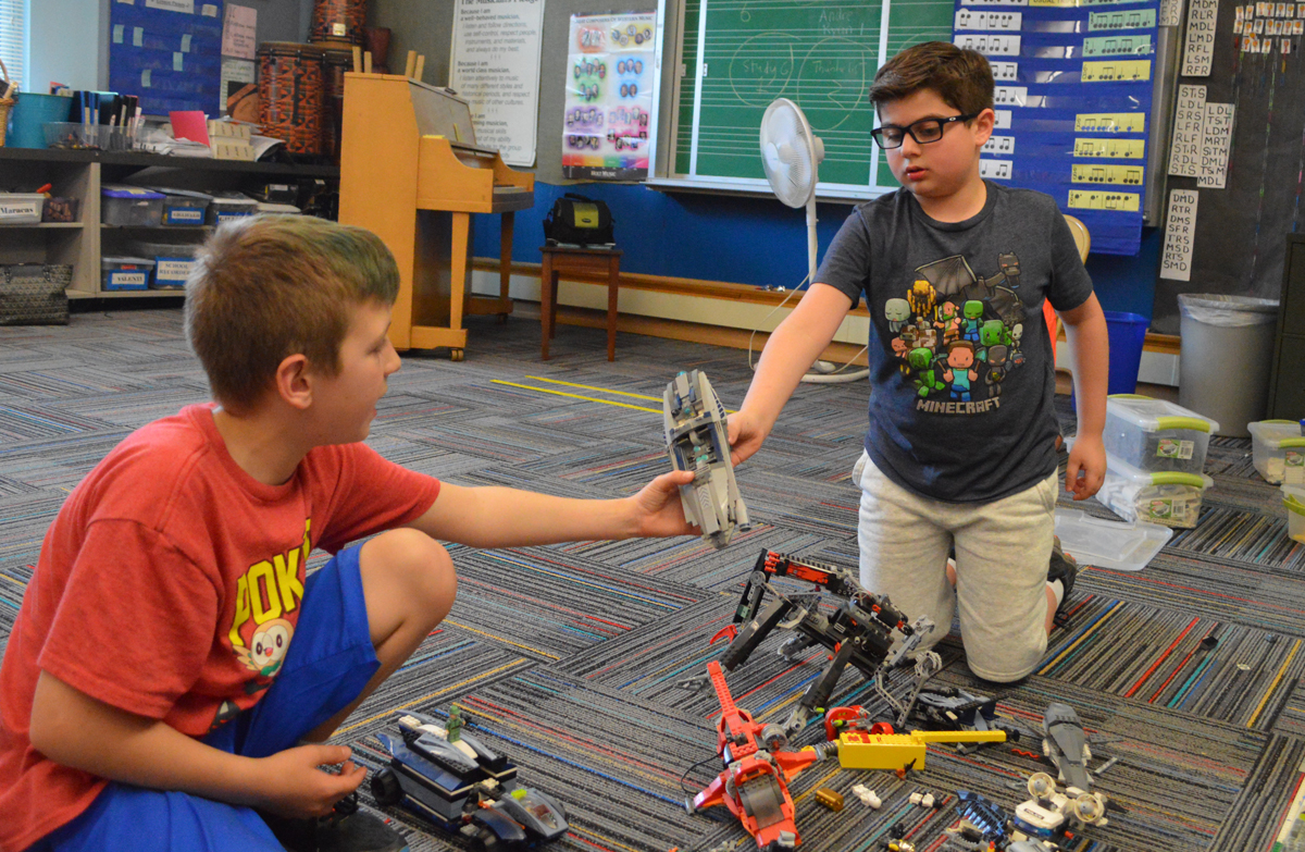 Students build with Legos at Create and Discover after school program