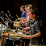 Students drum at spring concert