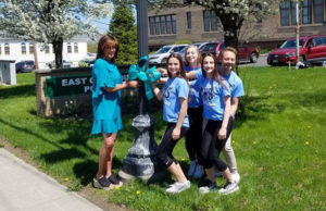 Mary Signorelli with cheer team at Turn the Town Teal presser