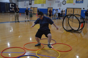 Student runs through obstacle course