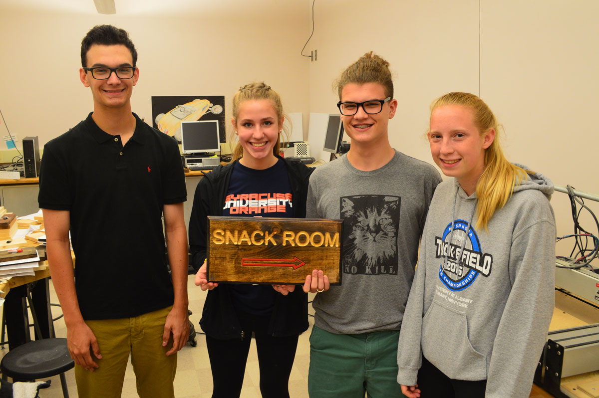 Students with a sign they created