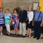Retiring staff members are recognized at a Board of Education meeting