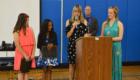 Mrs. Valenti speaks at the podium