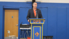 Principal Jack Alvey at podium