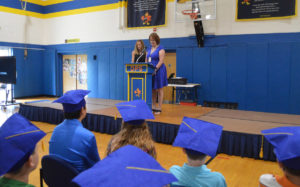 Mrs. Adams and Mrs. D'Amico at podium