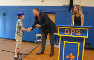 Student receives certificate from Mr. Alvey