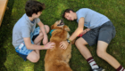 Students play with a dog