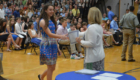 Student receives graduation certificate