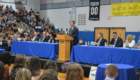 Superintendent Jeff Simons speaks from podium
