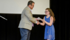Student receives certificate