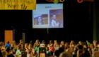Students watch a photo slideshow