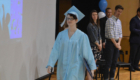 Student walking with diploma