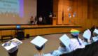 Mr. Simons speaks at podium