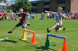 Students jumping over hurdles