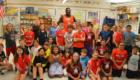 Joe Sykes with students