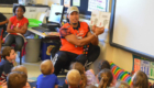 Malachi Jones reads to students