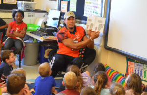 Malachi Jones reads to students