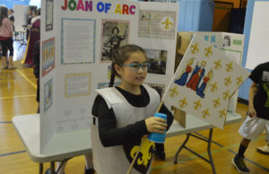 Student dressed as Joan of Arc