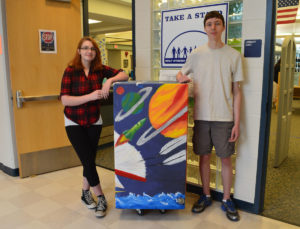 Amber Brown and Leif Haley with library book drop