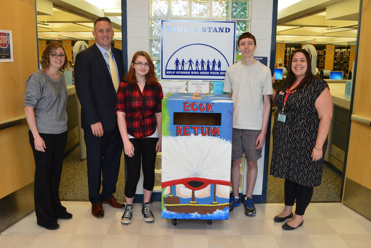 Students and teachers with new library drop box