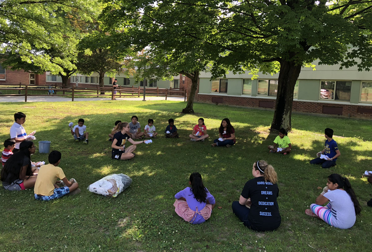 Students work together outside