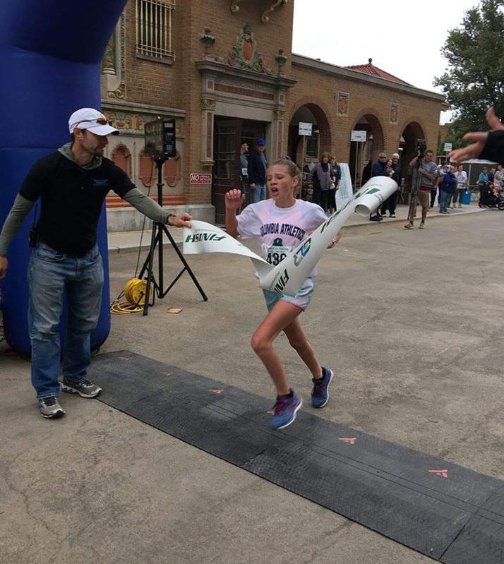 Abby Moxon at the finish line
