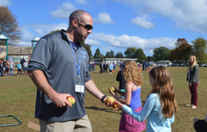Greg Jette hands apples out to students