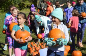 Students receive pumpkins