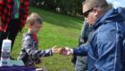 Coach Dedrick hands out apples