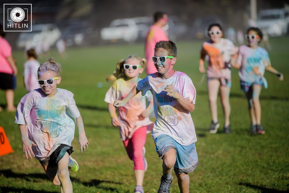 Students running in the Green Meadow Color Run