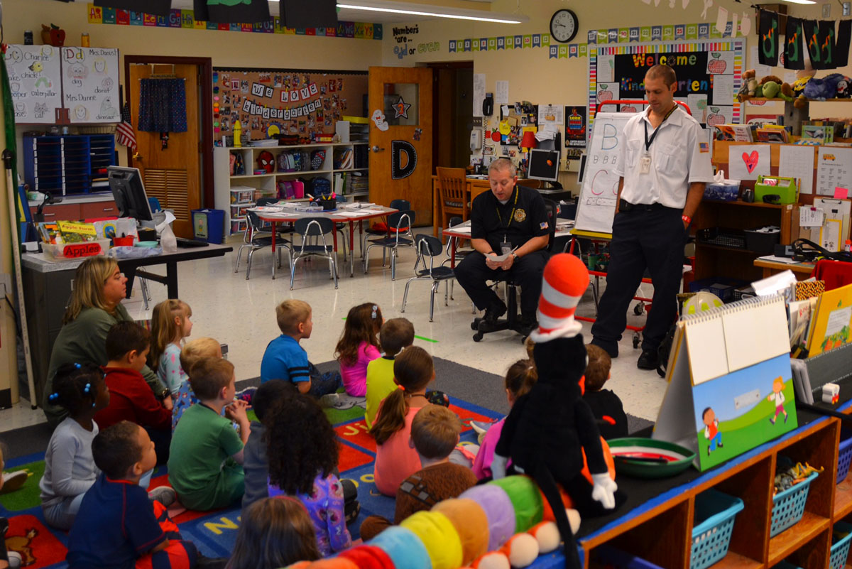 Firefighter teaches students about fire safety