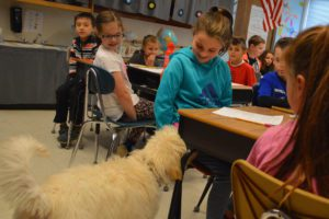 Auggie visits students