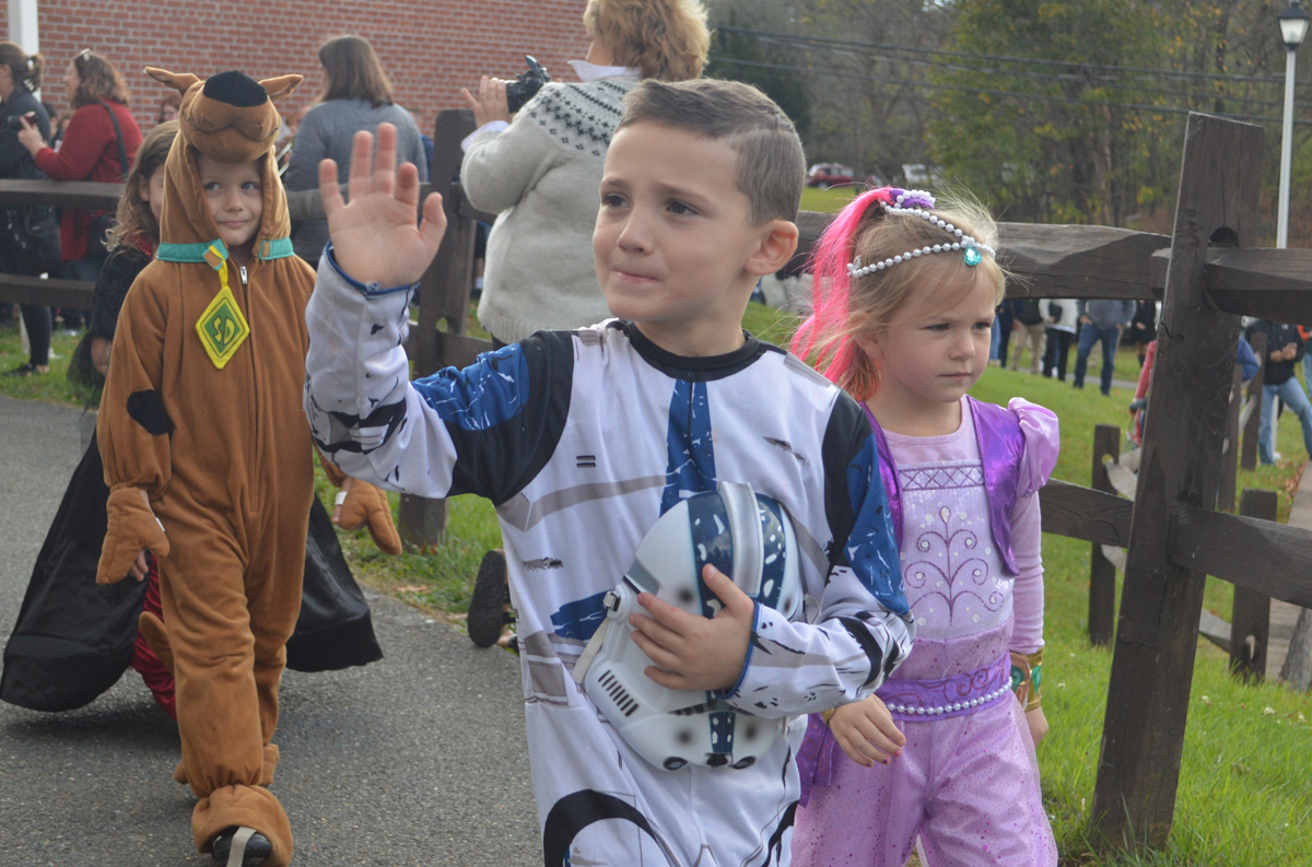 Students walk in Bell Top Halloween parade
