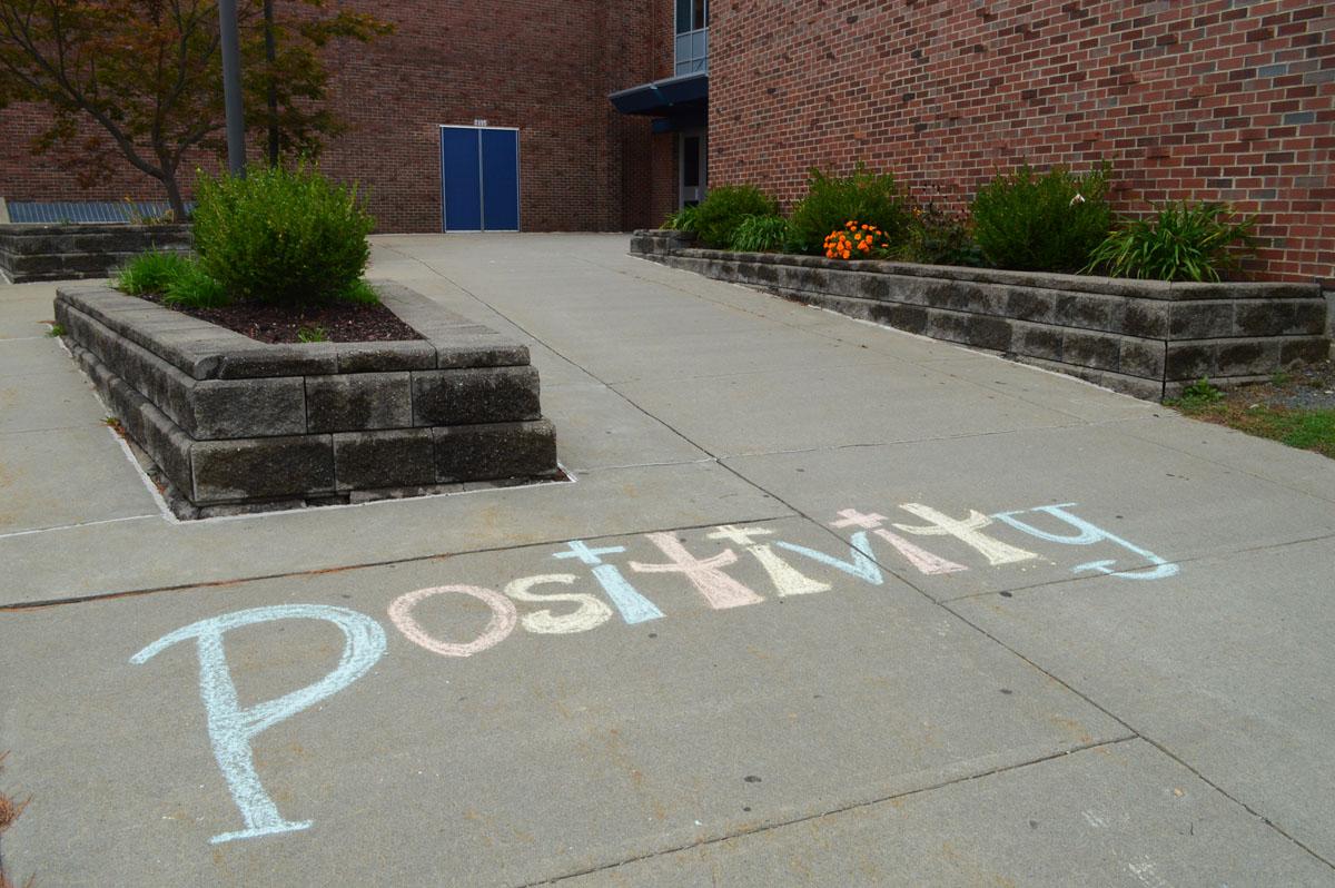 Artwork on sidewalk leading to Columbia High School