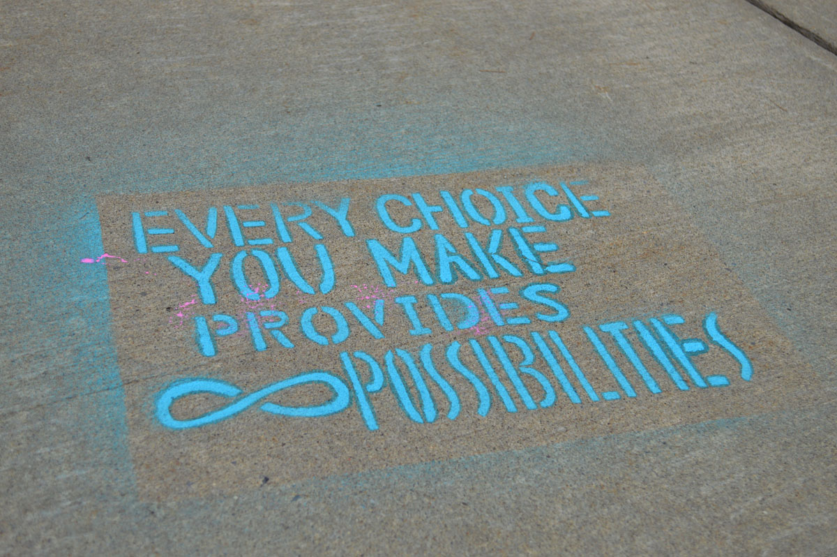 Artwork on sidewalk leading to Columbia High School