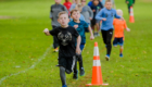 Students running in Apple Race