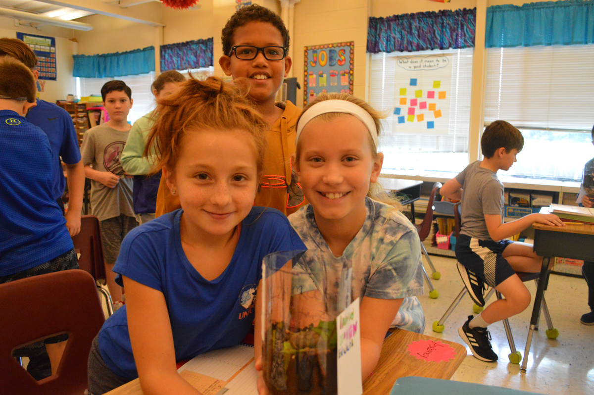 Students make an eco-column in science class