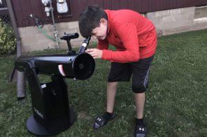 Ryan Krulikowski looking through telescope