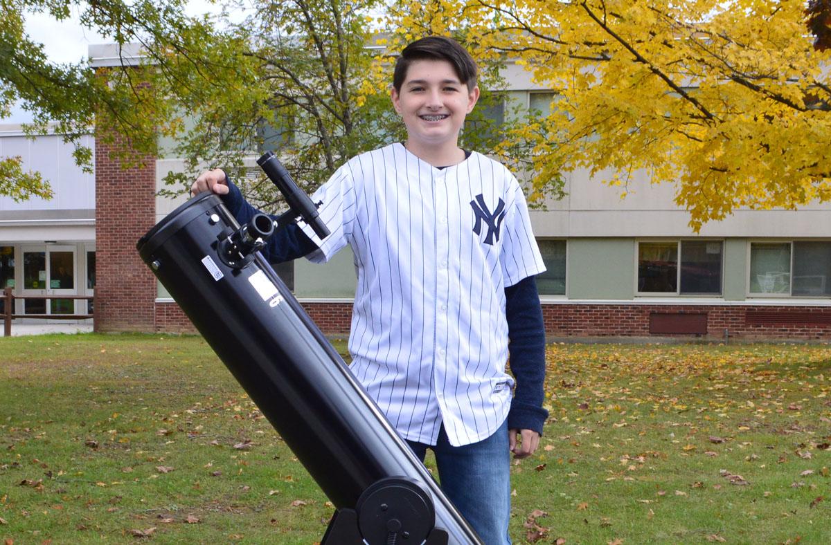 Ryan Krulikowski with telescope
