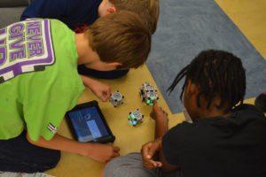 Students program a robot