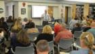 Teachers listen to professional development presentation