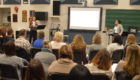 Teachers listen to professional development presentation