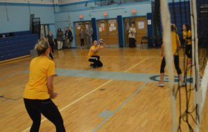 Teachers and staff playing volleyball