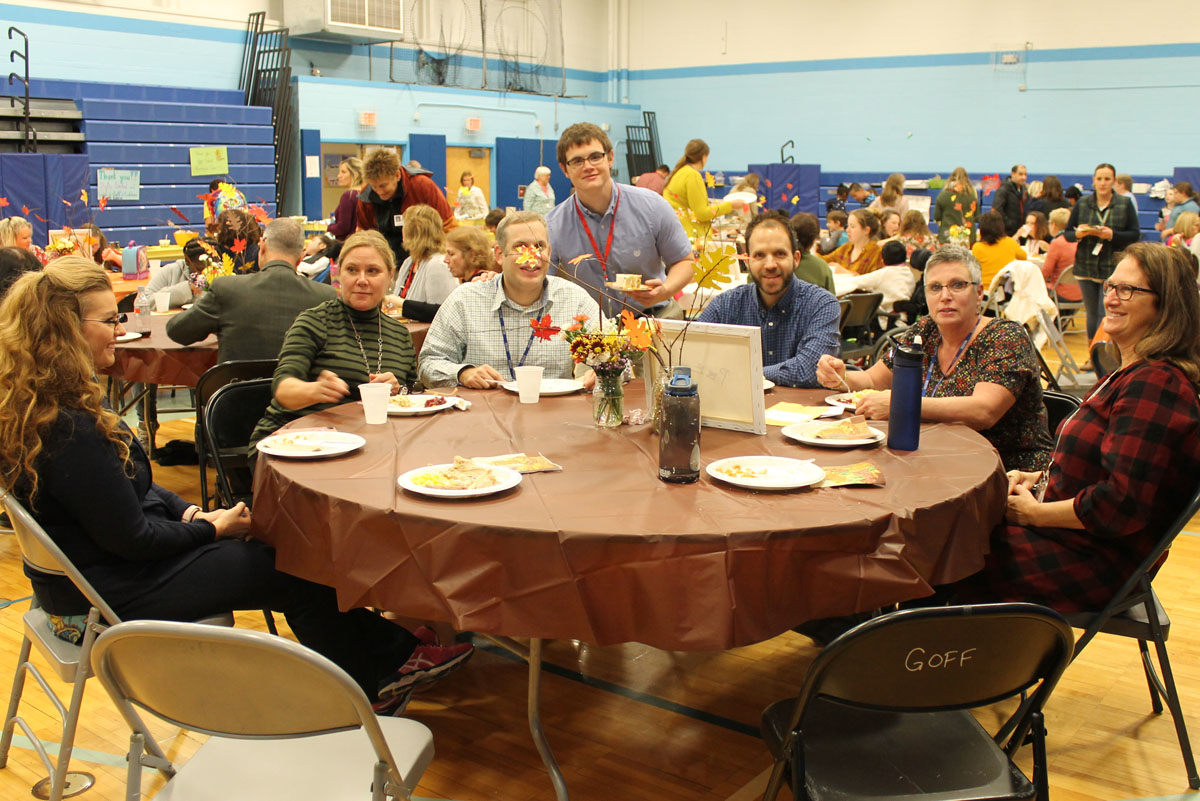 Staff eating at the Goff Thanksgiving Feast