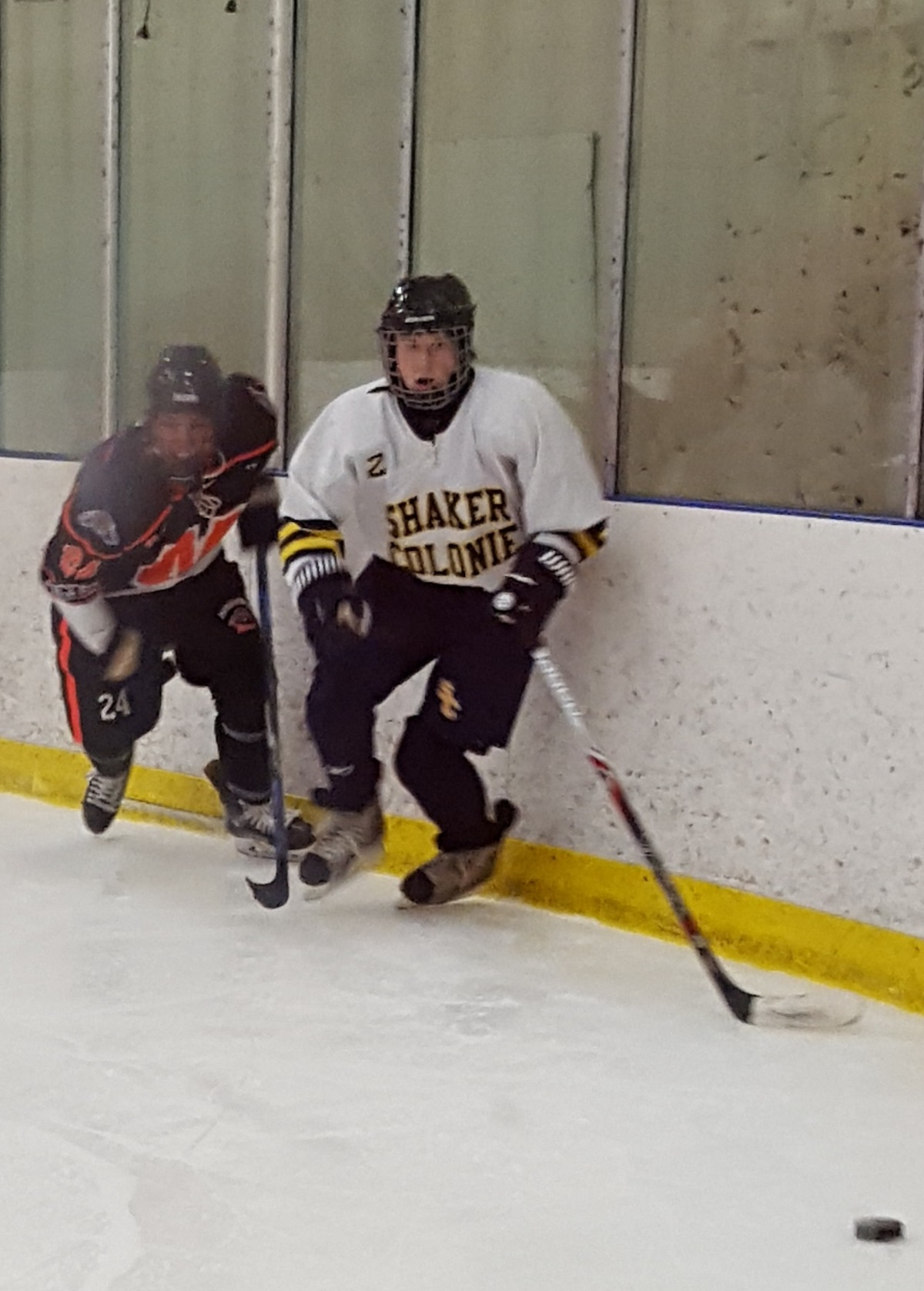 Collin Dougherty skates towards the puck