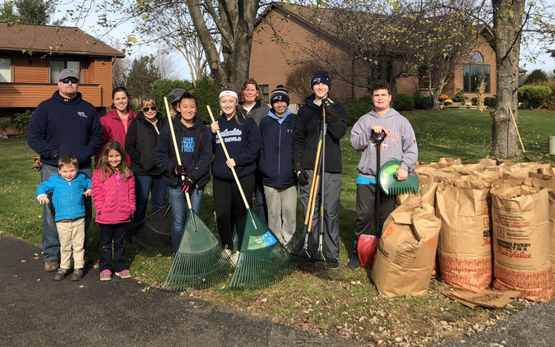 Teachers and Students Rake Lawns for Veterans Day