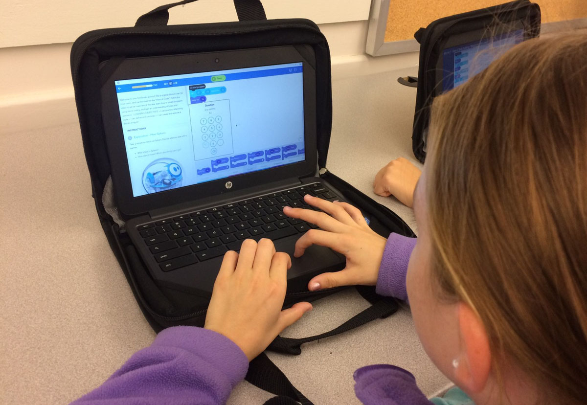 Student types on chromebook
