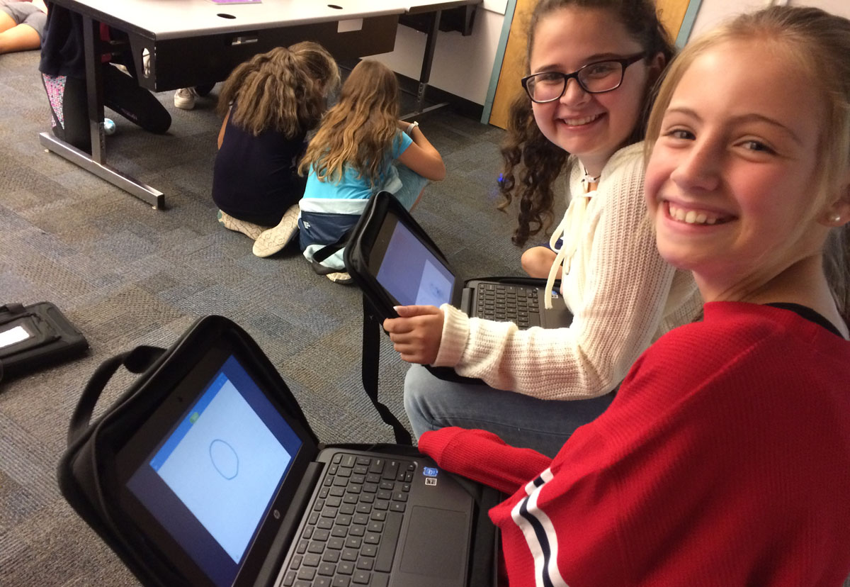 Students coding on chromebooks