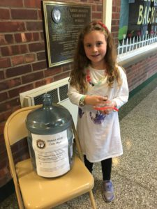 Student donates spare change to Hurricane Fundraiser